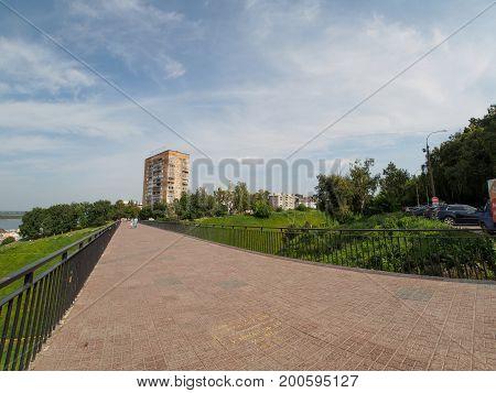 footbridge in nizhniy novgorod over ravine with blue sky