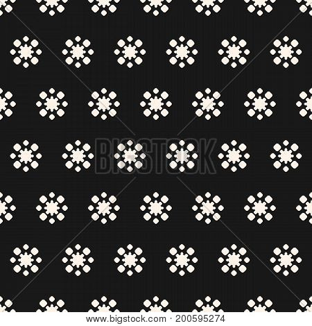 Floral pattern. Simple abstract floral geometric texture. Dark minimalist background. Perforated surface. Design pattern, textile pattern, covers pattern, digital pattern, web pattern, package pattern, decor pattern, fabric pattern.