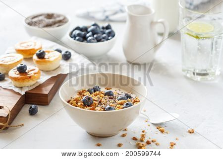 granola with yogurt and mini cheesecakes with blueberries for breakfast.