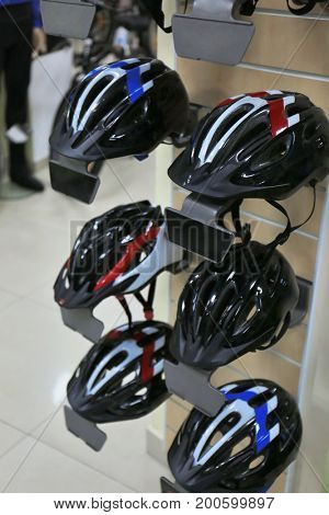 Stand with helmets in bicycle shop
