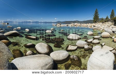 Beautiful boulders and crystal clear water of the lake Tahoe. Hidden Beach, Lake Tahoe - Nevada, USA. Panorama