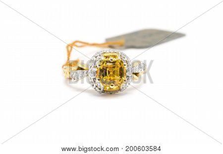 Gold Ring With Diamond And Yellow Sapphire Isolated