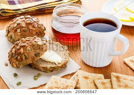 Black tea and healthy wholemeal buns for breakfast