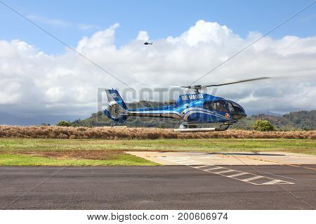 KAUAI HAWAII USA - SEPTEMBER 20 2012 : Blue Hawaiian helicopter lands on heliport in Lihue. Blue Hawaiian is the only helicopter tour company serving all four major Hawaiian Islands