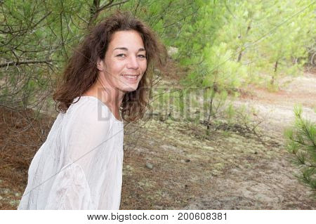 Beautiful Woman Standing In Country Field In Summer Time