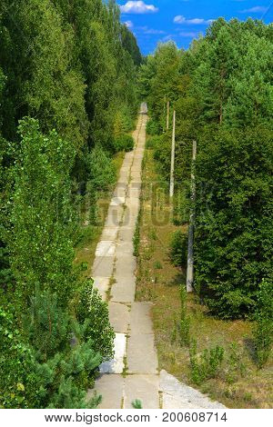An old abandoned road in the exclusion zone. Dead military unit. Consequences of the Chernobyl nuclear disaster August 2017.