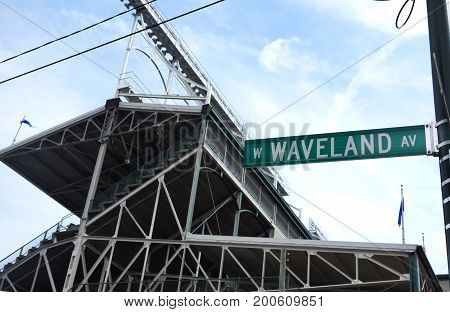 CHICAGOIL/USA - 8-09-2017: Wrigley Field in Chicago home of the Chicago Cubs showing the Waveland Ave. street sign