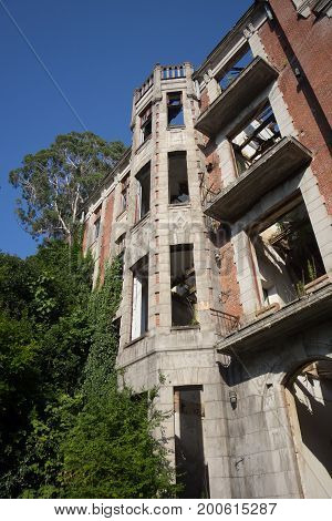 Overgrown ruins of abandoned palace of Smetskoy (Sanatorium named after Lenin), Abkhazia. Green post-apocalyptic concept