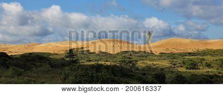 Summer day at the west coast of Denmark. Unique sand dune Rubje Knude. Lighthouse.