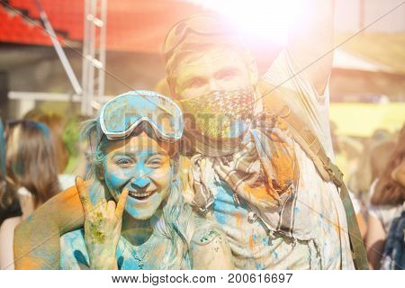 Moscow Russia Aug 19 2017: Happy painted couple with mask and happy faces at Holi festival