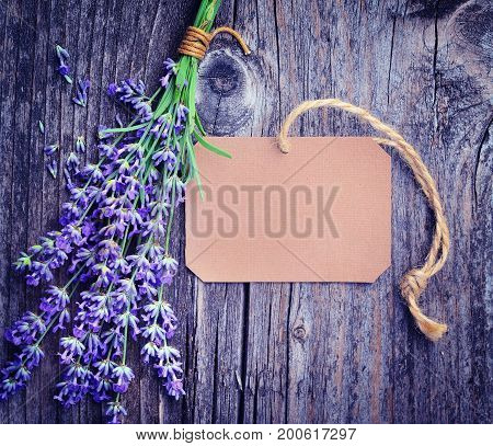 Lavender Flowers (lavandula) With Paper Tag On An Old Wooden Table