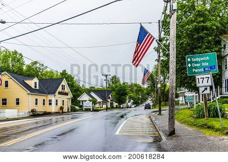 Blue Hill, Usa - June 9, 2017: American Flag On City Main Street In Maine During Rainy Cloudy Weathe