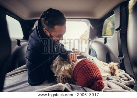 Romantic Couple Lying In Car Trunk