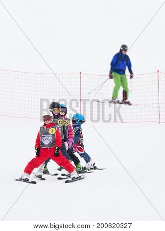 Sochi - March 28 2017: Children in mountain skiing learn to ski and a man goes skiing in the mountains March 28 2017 Sochi Russia