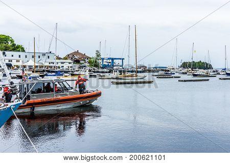 Camden, Usa - June 9, 2017: Marina Harbor In Small Village In Maine During Rain With Coast Guard Boa