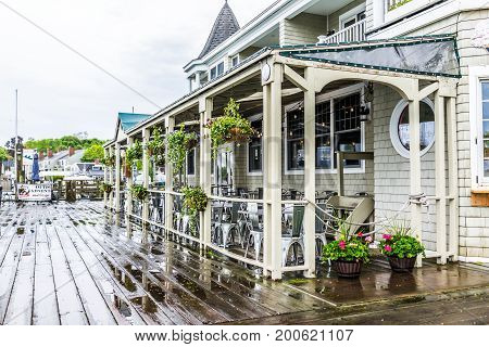 Camden, Usa - June 9, 2017: Empty Waterfront Wooden Restaurant Outside Seating Area In Small Village