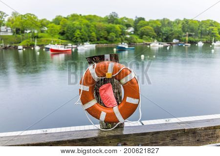 Empty Marina Harbor In Small Village Of Rockport, Maine During Rain With Boats And Life Buoy