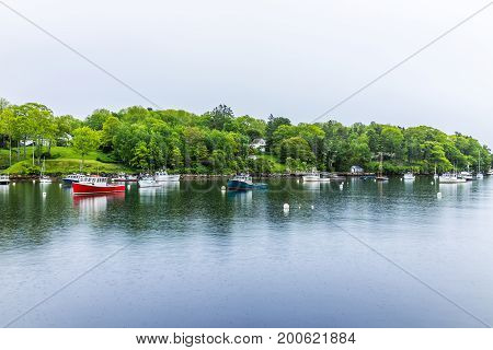 Empty Marina Harbor In Small Village In Rockport, Maine During Rain With Boats
