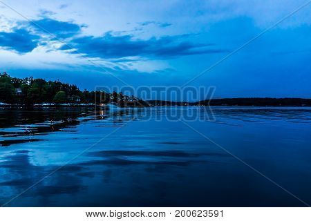 Blue Twilight In Evening At Boothbay Harbor In Small Village In Maine With Fast Motor Boat And Light