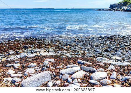 Rocky Public Beach Called Ship Cove By Portland Head Lighthouse In Cape Elizabeth, Maine