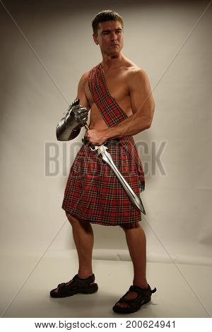 The sexy highlander prepares for the epic battle.