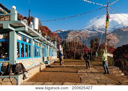 Pokhara, Nepal - March 13, 2013: People Outside Guesthouse In Tadapani Village With Beautiful View O