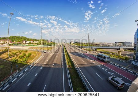 SOCHI RUSSIA - AUGUST 11: View at lines of city highway. Bus and cars drive on free roads without traffic jam. August 11 2017 in Sochi Russia.