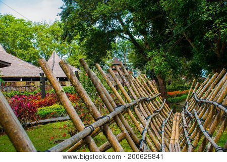 Traditional Bamboo Bridge To Be Crossed By The Visitors To Enter Deviate Culture Village. Sarawak, M