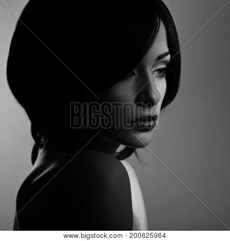 Beautiful Makeup Woman With Thinking Sad Look And Short Hair Style, Red Lipstick On Dark Shadow Back