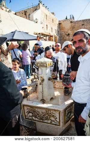 JERUSALEM, ISRAEL - OCTOBER 12, 2014:  Morning autumn Sukkot, Blessing of the Kohanim. The area in front of Western Wall of Temple filled with people. Ritual washing of hands