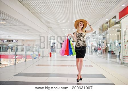 Portrait Of An Attractive Young Woman In Leopard Blouse, Black Skirt Posing With A Hat And Shopping