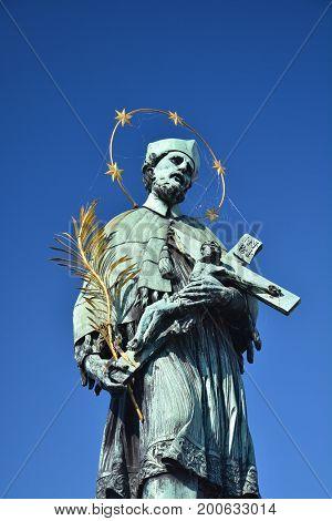 John of Nepomuk the saint of Bohemia statue at Charles bridge in Prague
