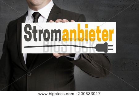 Stromanbieter (in German Electricity Provider) Sign Is Held By Businessman