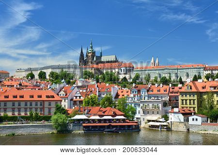 View above river on Hradcany castle and catherdal in Prague