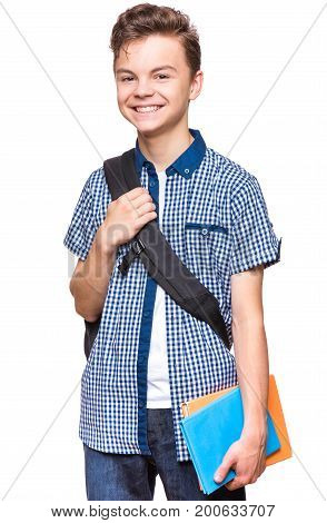 Portrait of young student with school bag and notebooks. Teenager smiling and looking at camera. Happy teen boy, isolated on white background.