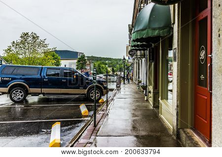 Belfast USA - June 9 2017: Empty small village in Maine during rain with buildings and stores on main street