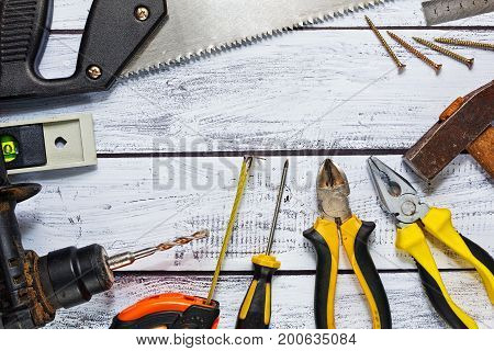 Variety Of Hand Tools On Work Desk