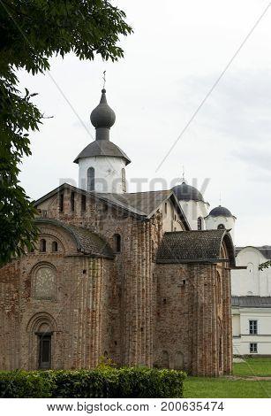 Yaroslav's court a medieval Orthodox churches the Church of St. Paraskeva St. Nicholas Cathedral bushes sky