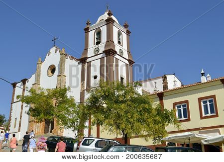 Silves Algarve Portugal - October 3 2014 : Tourists visiting Silves historical Cathedral in the Algarve
