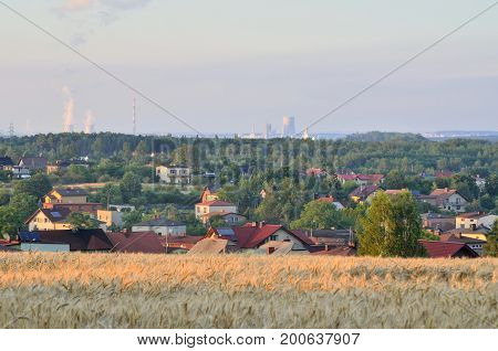 Summer urban landscape. View from the hill to the houses and power plants.