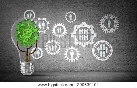Lightbulb with tree from gears inside placed against social gear structure sketched on grey wall. 3D rendering.