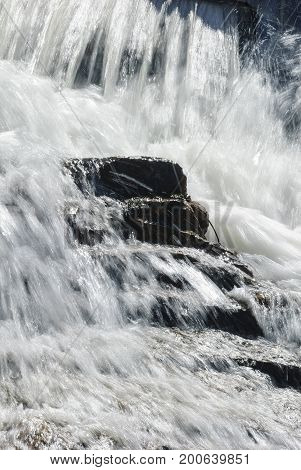 Rocky steps under turbulent Barden Reservoir waterfall