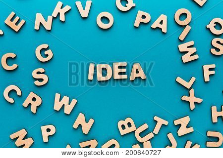Word Idea on blue background in wooden letters frame. Inspiration, creativity, imagination, brainstorm concept