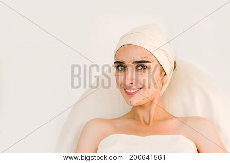 Beautiful young woman before plastic surgery operation. White background.