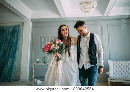 Cheerful Bride And Groom Having Fun Together. Newlyweds Laughing And Go Crazy. Artwork. Wedding Indo
