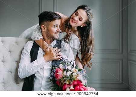 Cheerful Bride Hugging The Groom. Newlyweds Laughing And Looking At Each Other. Artwork. Wedding. So
