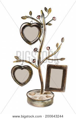Decorative wrought-iron frame with photo frames in the shape of heart isolated on white background