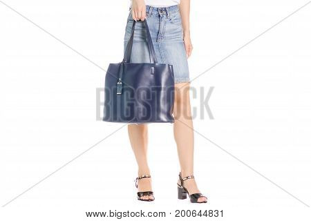 Legs in shoes young girl bag on white background isolation