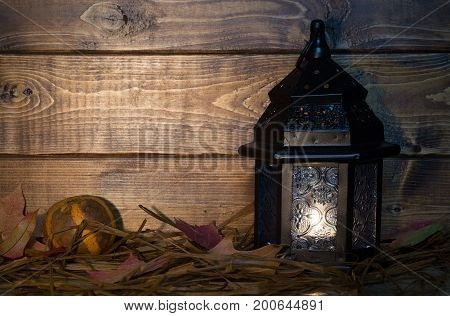 Glowing lantern on wood background with copy space