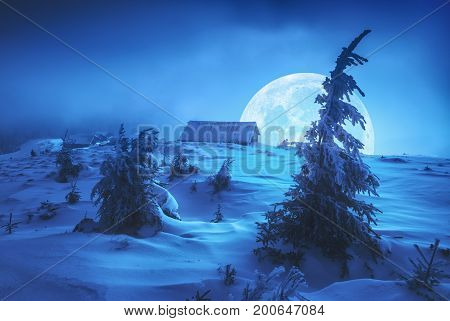 Rising Of The Moon Above The Winter Village